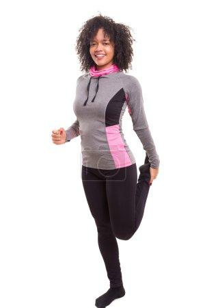 Beautiful african woman exercising