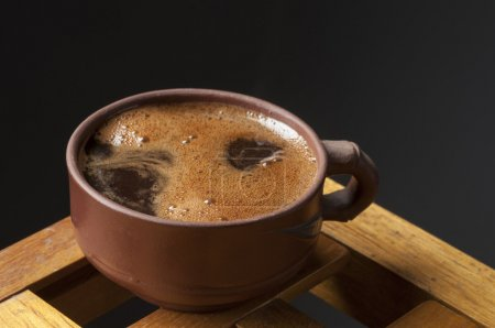 Photo for Black coffee cup over dark background - Royalty Free Image