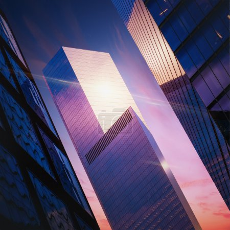 Photo pour Terrain futuriste avec gratte-ciel avec reflet du soleil couchant - image libre de droit