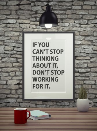 Photo for Inspirational quote on picture frame over a dirty brick wall. IF YOU DON'T STOP THINKING AOUT IT, DON'T STOP WORKING FOR IT. - Royalty Free Image