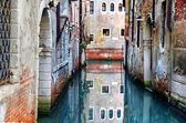 canal in venice with reflections