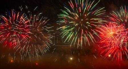 Foto de Holiday firework in the dark sky - Imagen libre de derechos