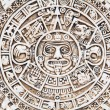 Fragment of the Mayan symbolic sun carved on the s...