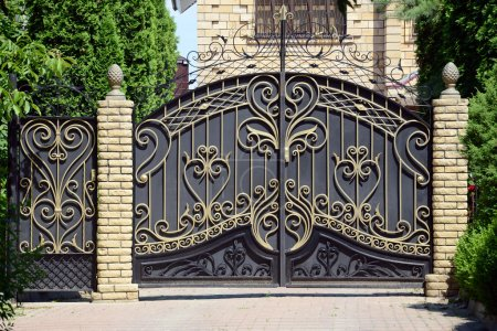 Photo for Forged gates and gate. Front of the house. - Royalty Free Image
