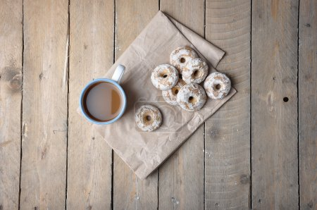 Good morning or Have a nice day Merry Christmas message concept - blue cup of frothy coffee gingerbread white chocolate cookies