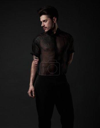 Elegant young handsome man. Studio fashion