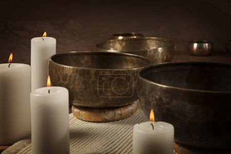 Photo for Tibetan singing bowls with burning candles close-u - Royalty Free Image