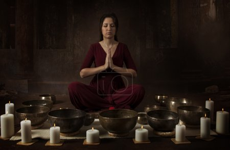 Young woman with Tibetan bowls