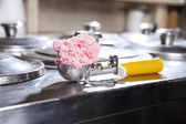 Strawberry Ice Cream In Scoop On Counter At Store
