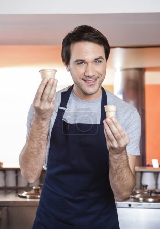 Waiter Choosing Between Cup And Cone At Ice Cream Parlor