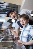 Surprised Boy With Chocolate Ice Cream Standing By Worker