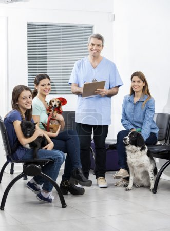 Nurse And Owners With Pets
