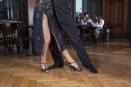 Low Section Of Dancers Doing Tango In Restaurant