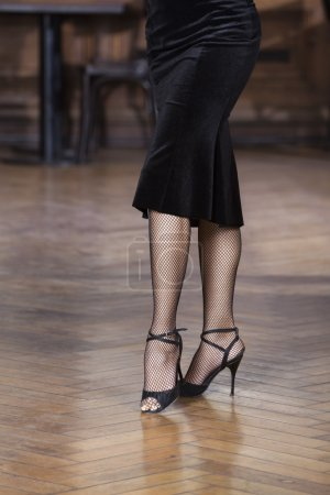 Low Section Of Woman Performing Tango On Wooden Floor
