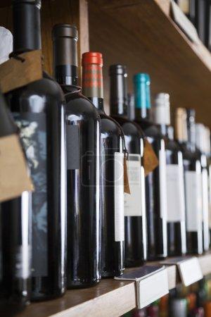 Row Of Wine Bottles Displayed On Shelf