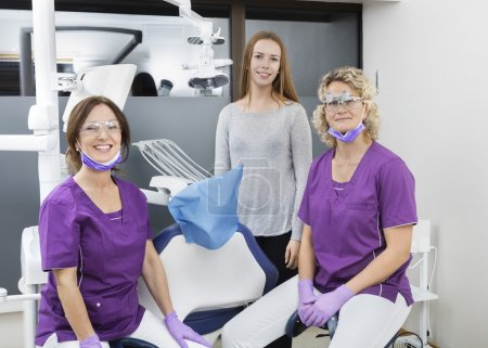 Female Dentists And Patient Smiling In Clinic