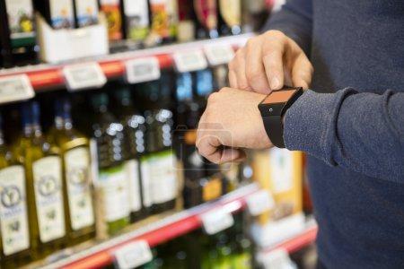 Customer Touching Smartwatchs Screen