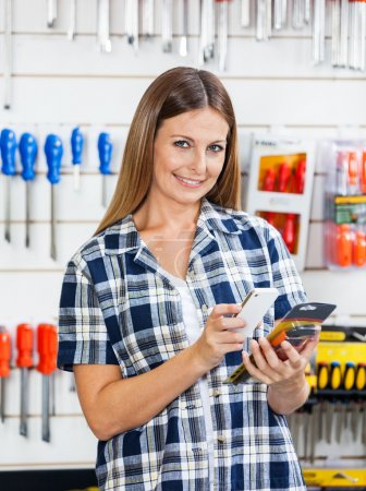 Female Customer Scanning Products Barcode Through Mobilephone
