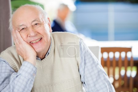 Portrait Of Smiling Senior Man At Nursing Home