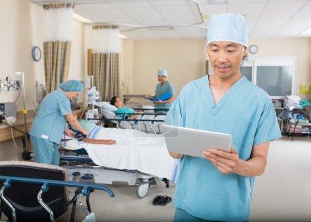 Nurse Using Digital Tablet In Ward