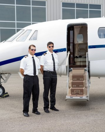 Pilots Standing By Private Jet