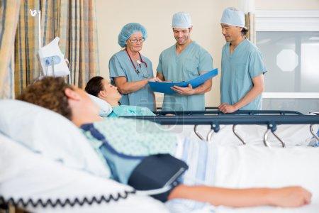 Nurses Examining Patients Report