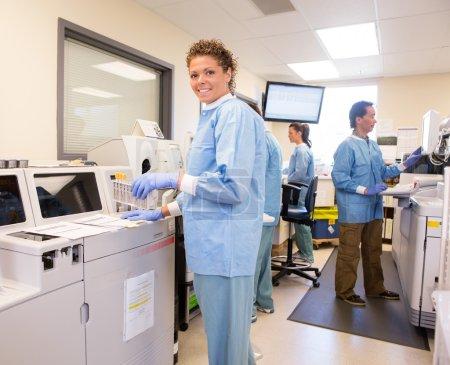 Lab Tech using backup Chemistry Analyzer