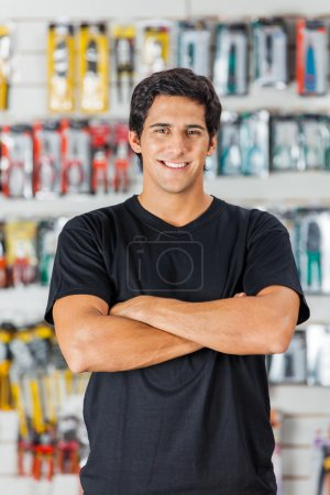 Man Standing Arms Crossed In Hardware Store