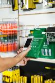 Hands Scanning Products Barcode Through Cellphone