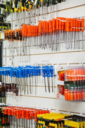 Photo for Blue and orange screwdrivers hanging in hardware shop - Royalty Free Image