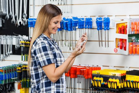 Customer Checking Information Of Screwdriver On Mobilephone