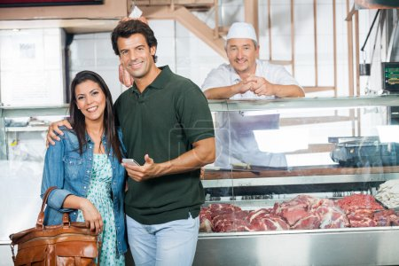 Couple Smiling In Butchery
