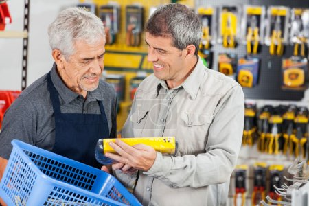 Salesman Assisting Customer In Buying Product