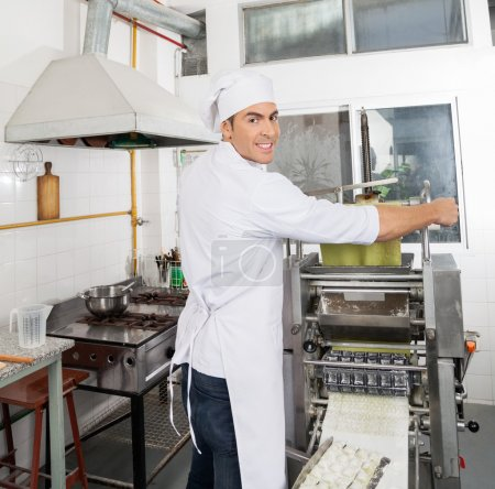 Smiling Chef Processing Pasta Sheet In Machinery