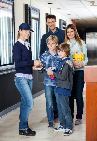 Family Getting Tickets Checked By Worker At Cinema