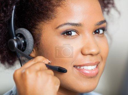 Smiling Female Customer Service Representative Wearing Headset