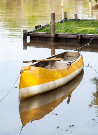 Photo for Empty canoe moored in calm lake - Royalty Free Image