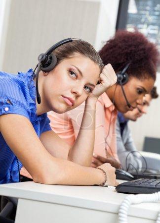 Tired Customer Service Representative In Office