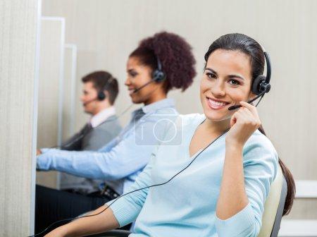 Portrait Of Smiling Female Customer Service Representative Weari