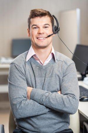 Confident Customer Service Representative Sitting In Office