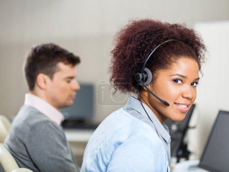 Customer Service Representative Wearing Headset At Office Desk