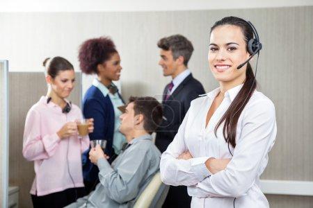 Smiling Female Customer Service Representative Standing Arms Cro