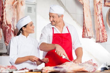 Butchers Looking At Each Other While Working