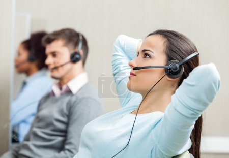 Relaxed Female Customer Service Representative Wearing Headset A