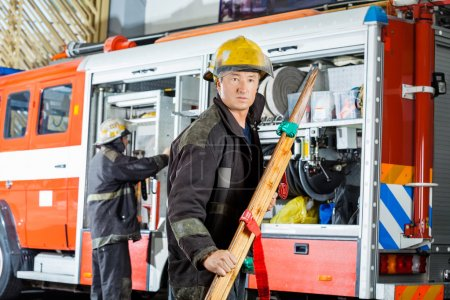 Confident Fireman Holding Wooden Stretcher