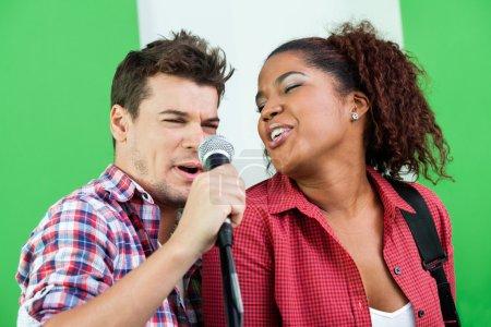 Singers Performing In Recording Studio