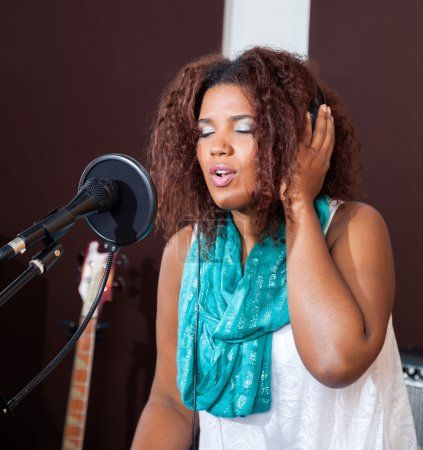 Singer With Eyes Closed Performing In Studio