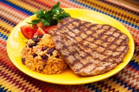 The steak with rice and beans