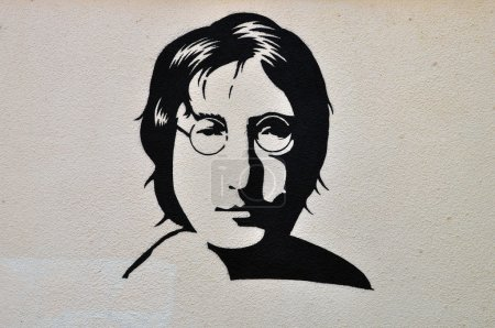 Photo for ATHENS, GREECE - AUGUST 30, 2014: John Lennon portrait stencil graffiti urban art on textured wall. - Royalty Free Image
