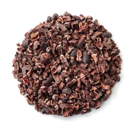 Circle of cacao nibs isolated on white background...